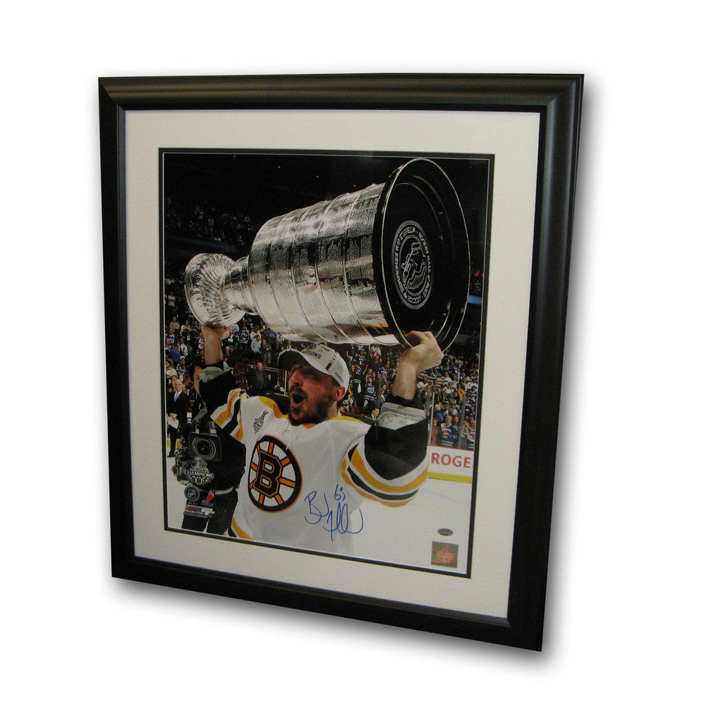 Autographed Brad Marchand 16-by-20 inch framed Boston Bruins photo.