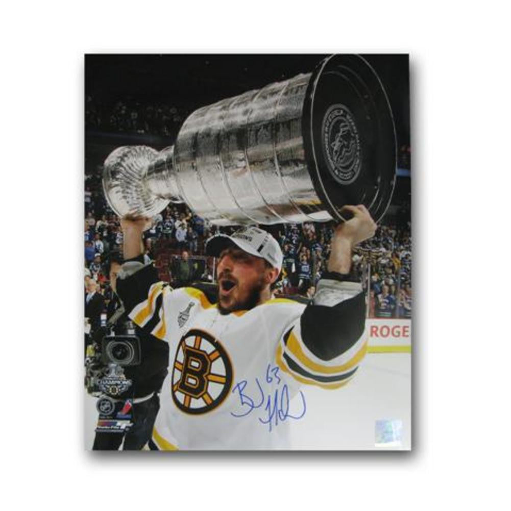 Autographed Brad Marchand 16-by-20 inch unframed Boston Bruins photo.