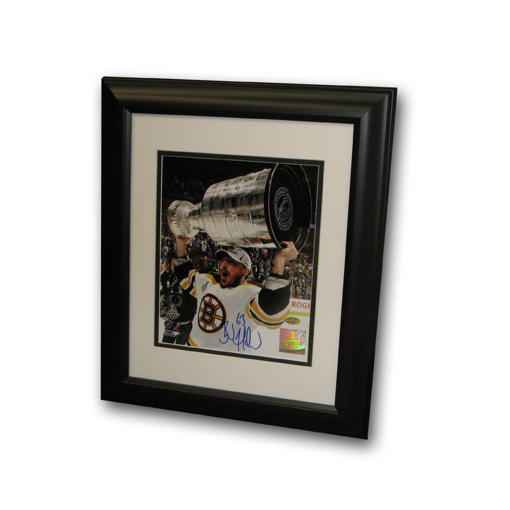 Autographed Brad Marchand 8-by-10 inch framed Boston Bruins photo.