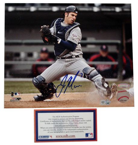 "Autographed Joe Mauer 8x10 unframed photo inscribed ""1st AL catcher batting champ"". The photo is of Joe blocking the plate. In 2009 - Peazz.com"