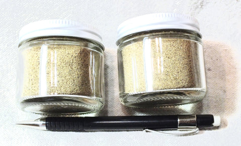 sand - dune sand - fine-grained yellow-brown dune sand derived from a sandstone member of the Menefee Formation in New Mexico - set of two 2-ounce jars