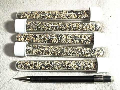 sand - set of five tubes of sand derived from coral and basalt