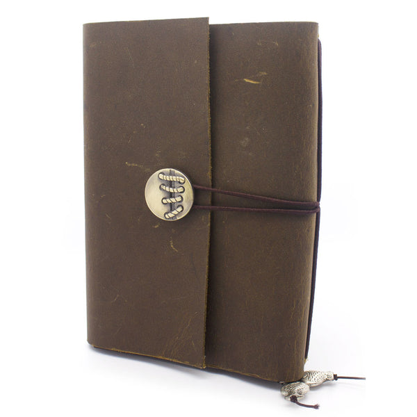 brown wrapped in leather journal leather notebook