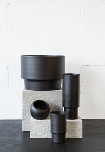 Black pots on table