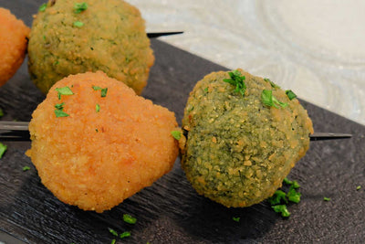 Spinach and bosciaola arancini served on a squewer - Mannarinu - 1