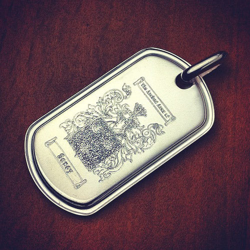 Men's dog tag custom engraved with a family crest
