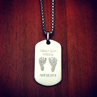 Sterling silver dog tag for a new dad engraved with actual baby footprints and details