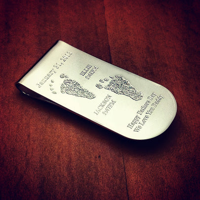 Money clip engraved with actual baby footprints of two children, names and birth dates