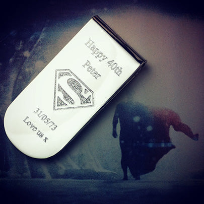 Silver money clip custom engraved with the Superman shield.