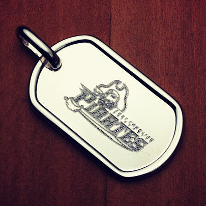 Sterling silver men's dog tag custom engraved with a team logo.