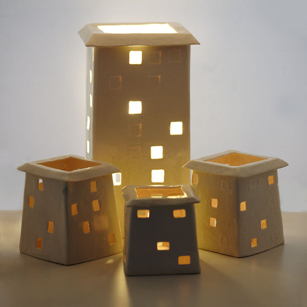 Group of lit light houses by Belinda Ormond