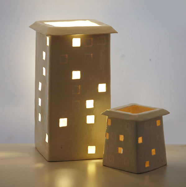 Two lit light houses by Belinda Ormond