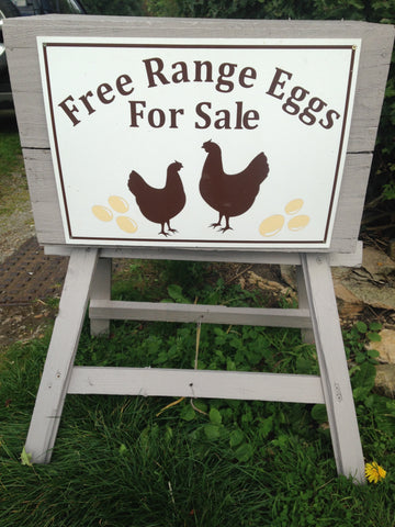 Gate stall photo of a sign advertising eggs for sale