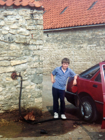 Pheasant Plucker and Son's blog on 7 things you know if you're a farm kid. A photo of a small boy filling a car up with petrol
