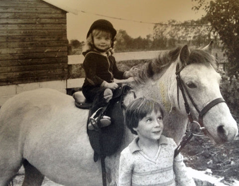 Pheasant Plucker & Son riding a pony aged two years old. Black and white photo.