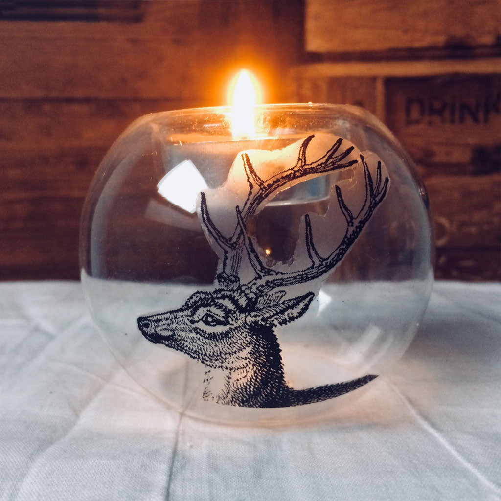 Glass tealight holder in stag design