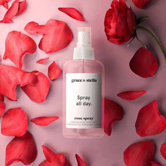 model holding rose spray