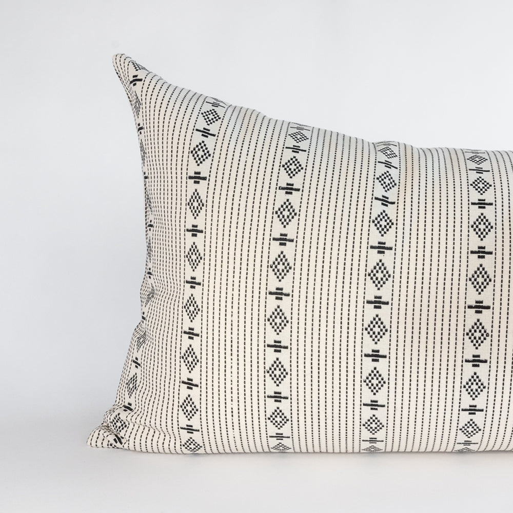 cream and black diamond and stripe pattern pillow detail