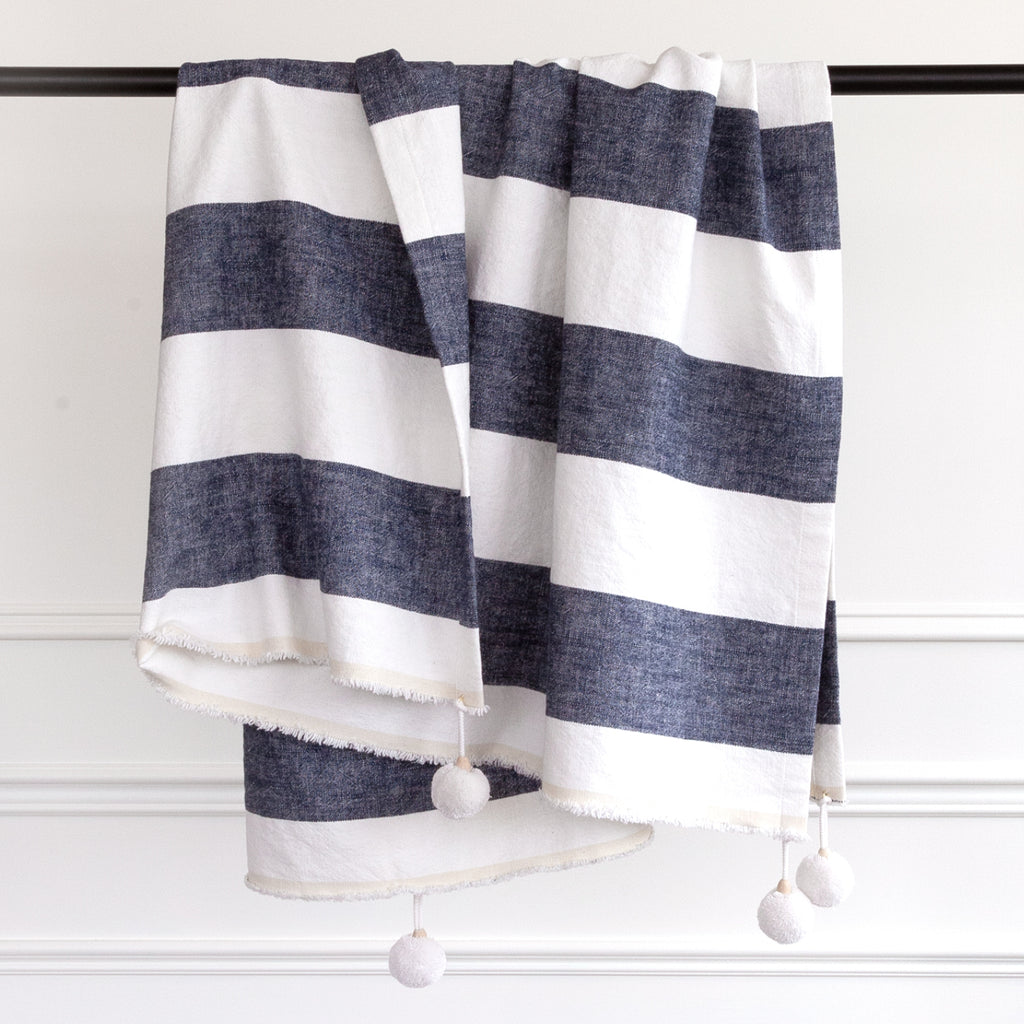Charlie navy stripe linen pompom throw from Tonic Living