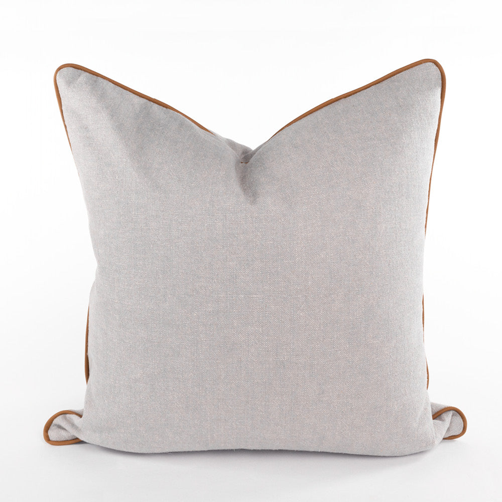 Cleary Pewter, a taupe linen blend pillow with brown faux leather piping from Tonic Living
