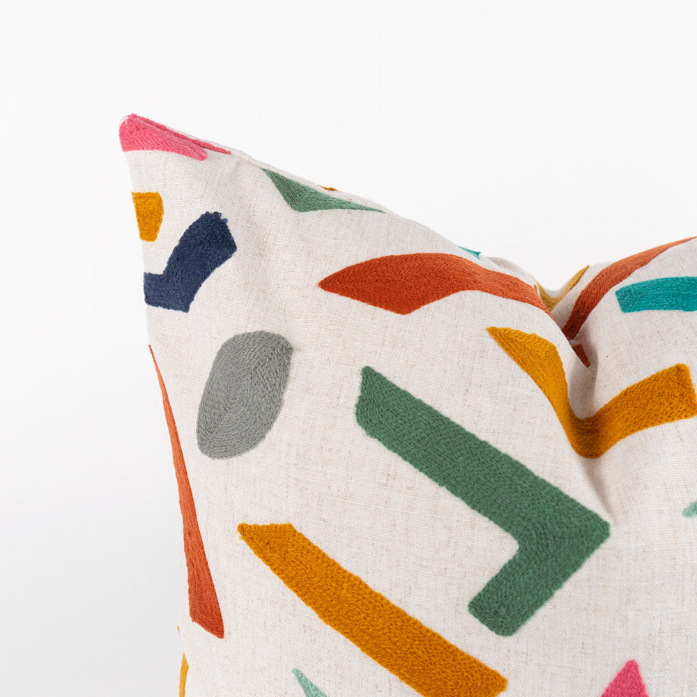Delano Chroma, a colorful geometric pattern embroidered pillow from Tonic Living