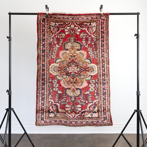 Freda Vintage Rug, a faded coral red Persian rug from Tonic Living