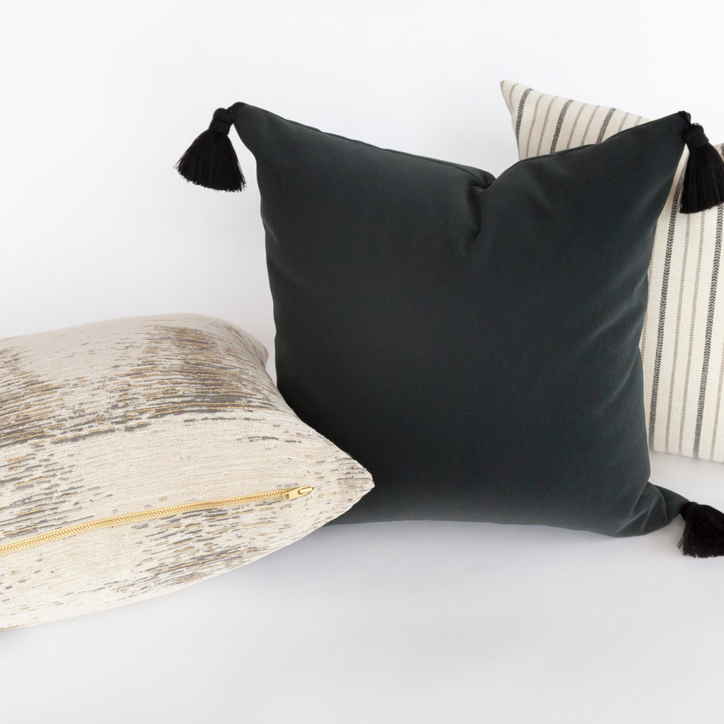 Lilith charcoal dark grey pillow with black tassels from Tonic Living
