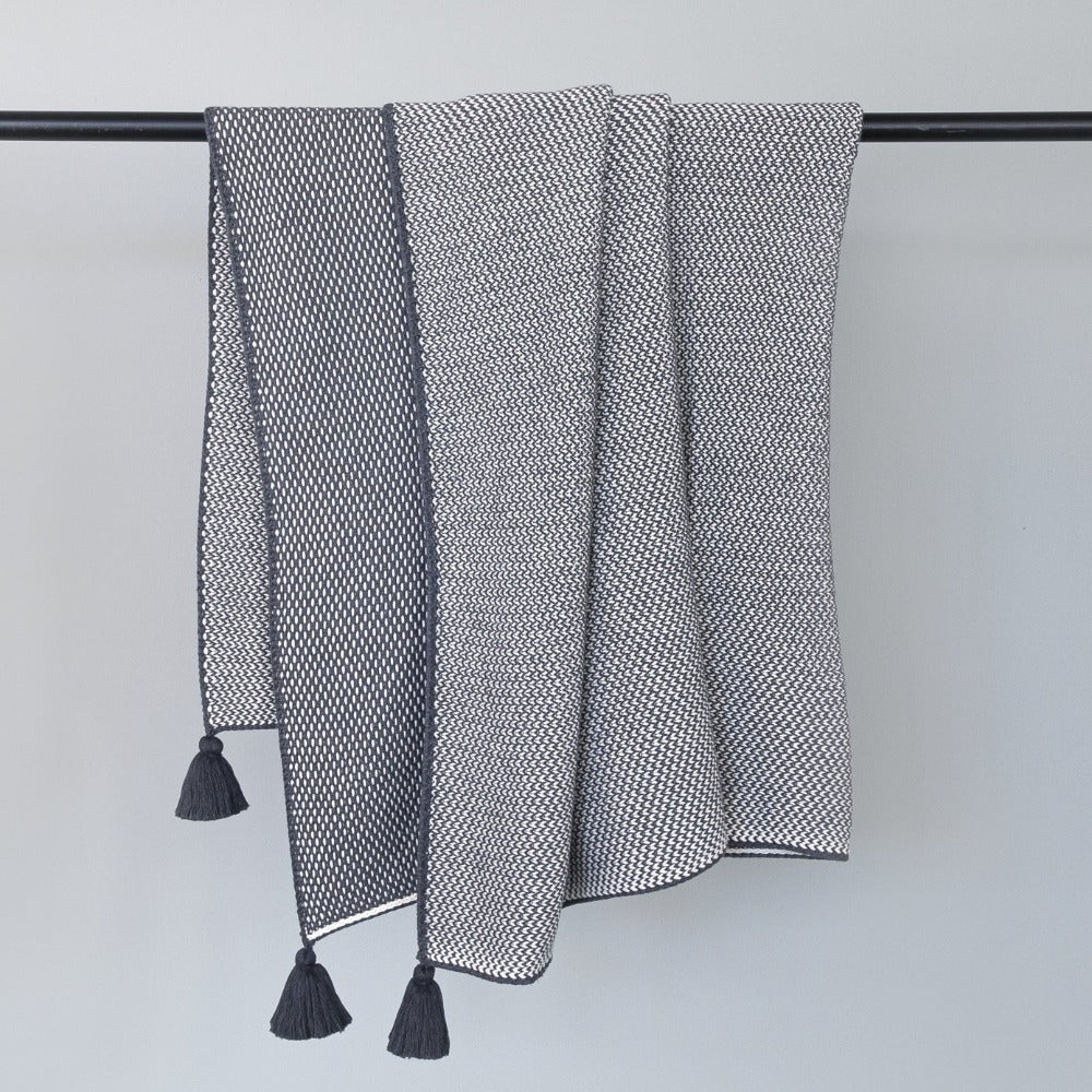 Lottie Tassel Throw, Charcoal, A gray and cream sweater knit blanket with tassels from Tonic Living