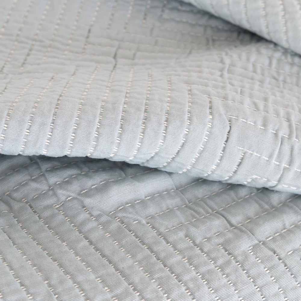 Pollenca Fabric, Mist, a light blue Ellen Degeneres quilted fabric from Tonic Living