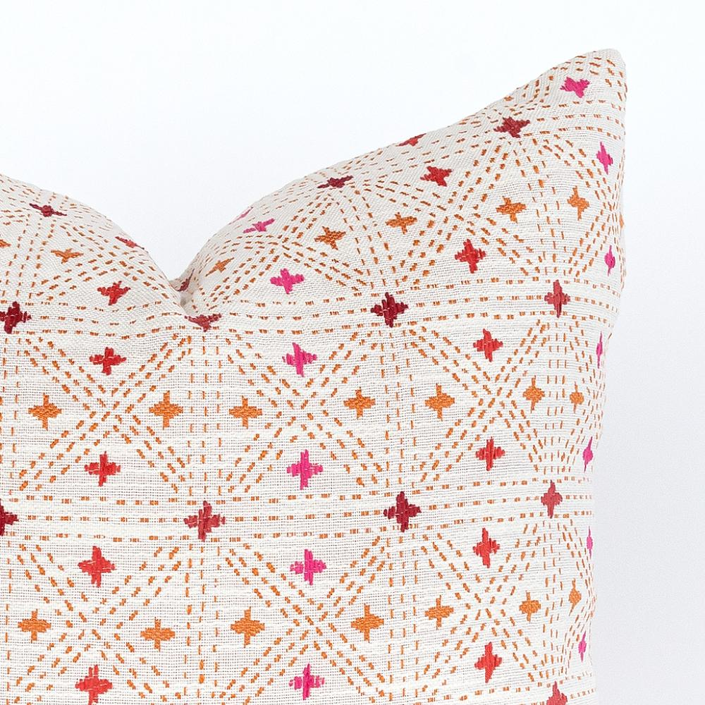 Raya indoor/outdoor pink, orange and red geometric patterned outdoor pillow from Tonic Living