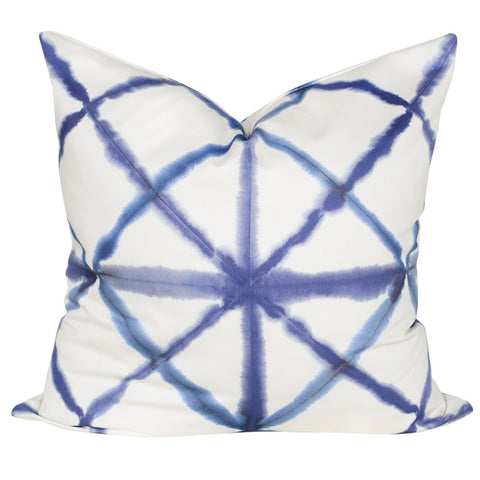 Shibori, Indigo - An indigo Shibori pillow in white and blue.