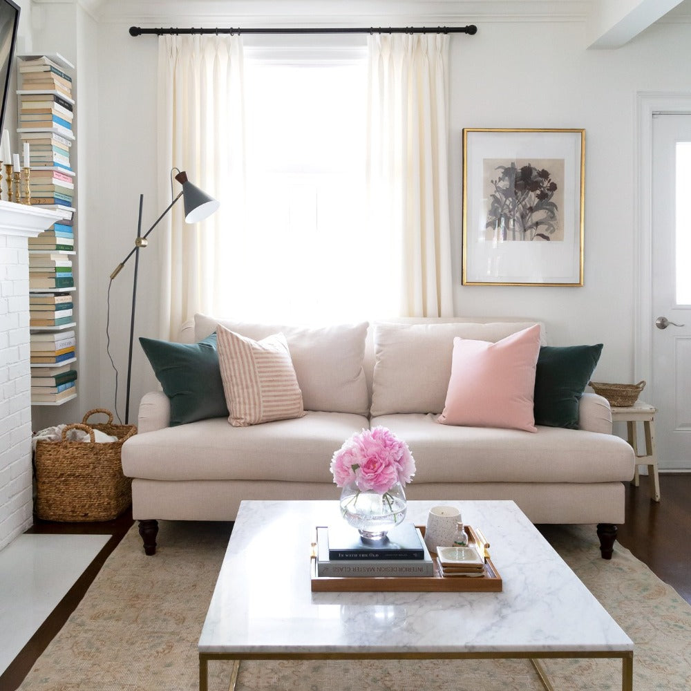 Tonic Living pillows on a beige sofa