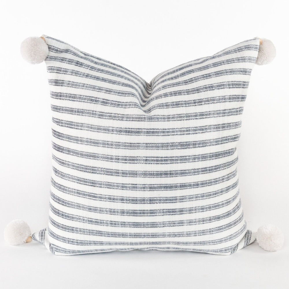 Thompson Denim, a blue stripe pillow with pom poms from Tonic Living