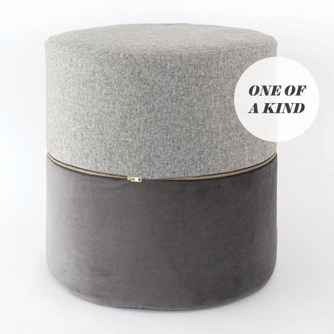 Two Tone Gray Round Ottoman, a Tobermory felt and charcoal velvet round ottoman stool from Tonic Living