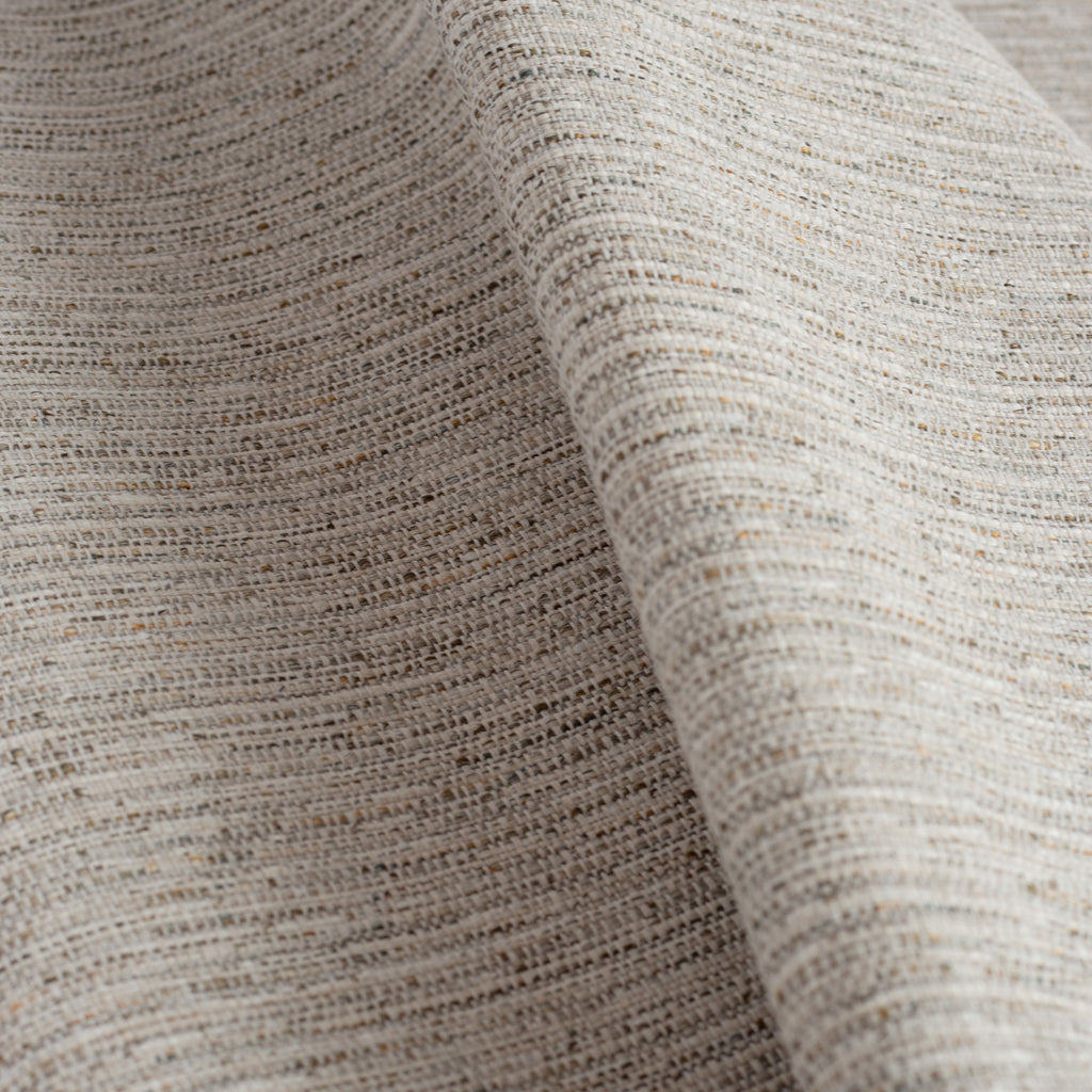 a textured warm grey upholstery fabric
