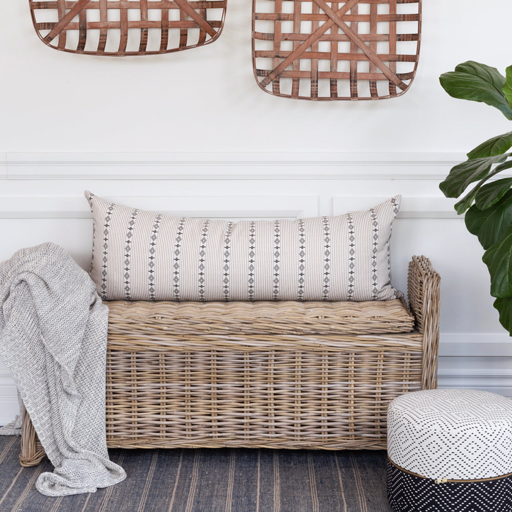 Boho cream and black long lumbar pillow on wicker bench