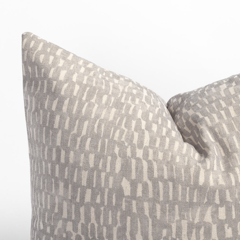 Avareno 20x20 pillow silver, a light grey and sandy beige small scale abstract print pillow : close up corner detail