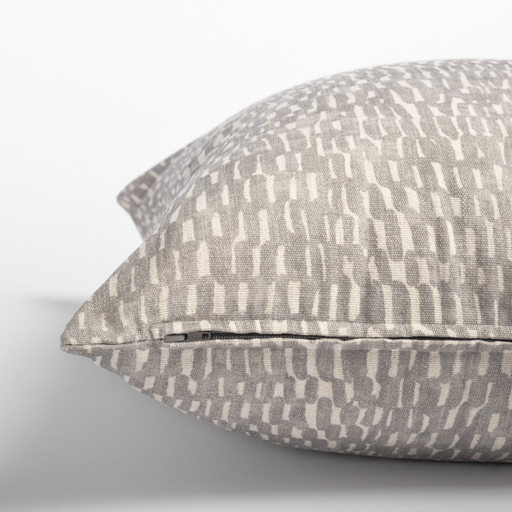Avareno 20x20 pillow silver, a light grey and sandy beige small scale abstract print pillow : close up zipper detail