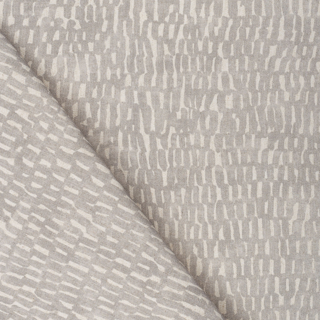 Avareno Silver, a light gray and sandy beige small scale abstract print fabric from Tonic Living
