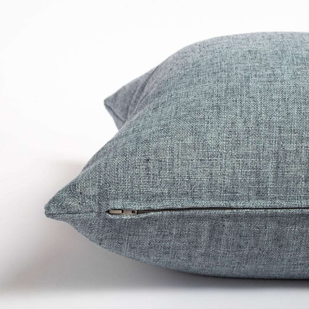 chambray blue throw pillow zipper detail