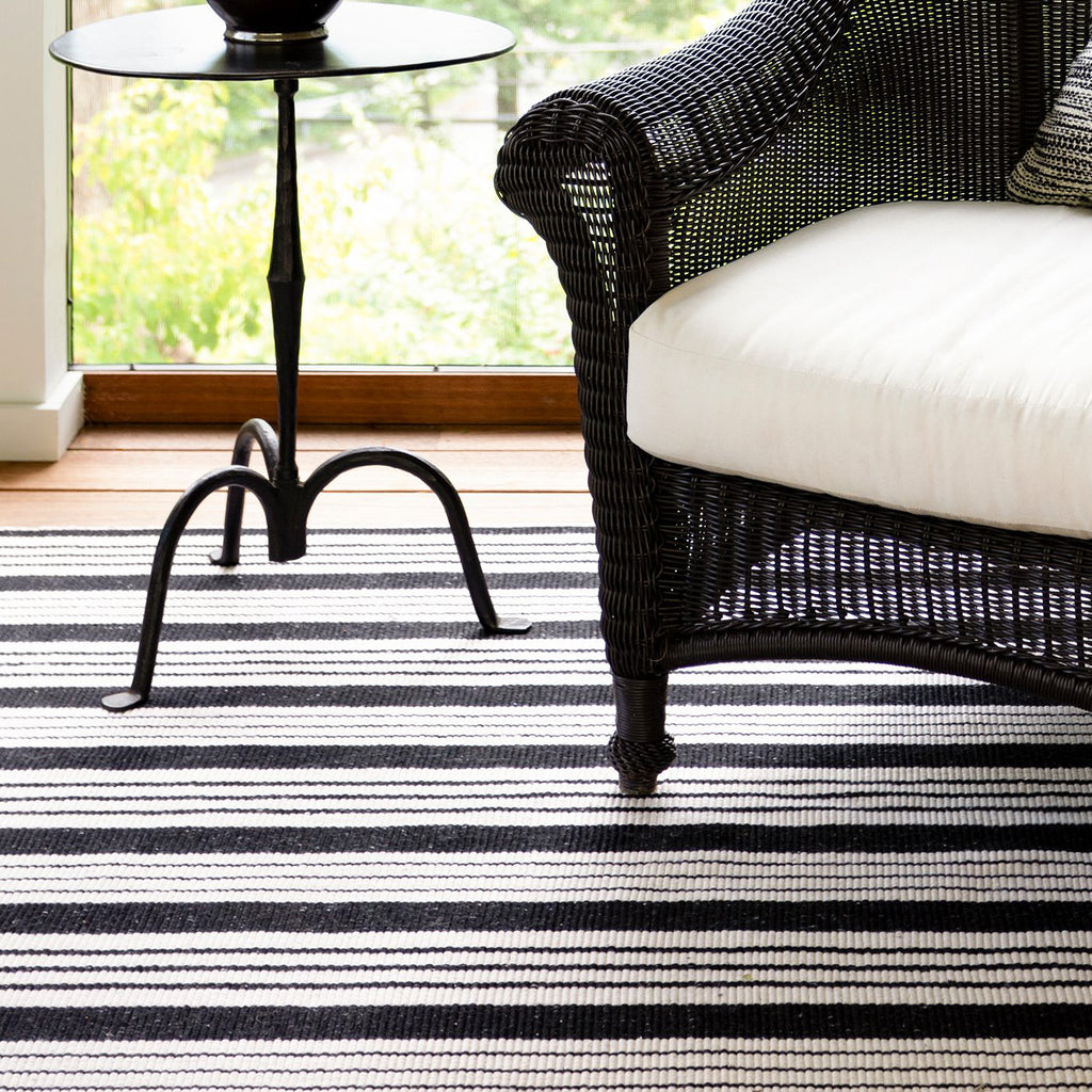 black and white striped flat weave indoor outdoor rug