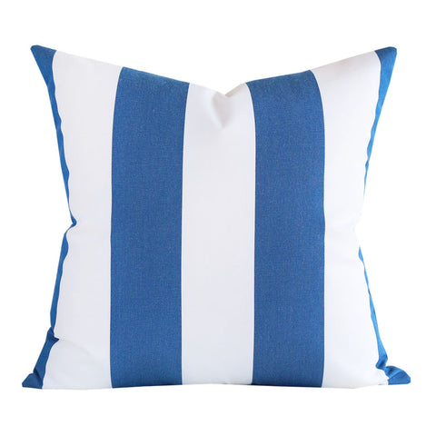 A blue and white outdoor pillow with broad vertical stripes.