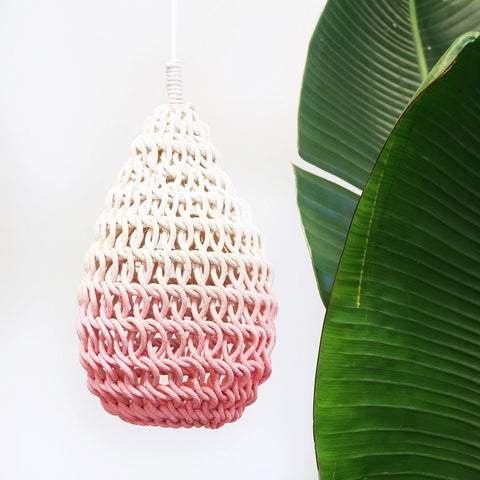 These handwoven light fixtures have an organic form and texture, giving your space a very unique lighting effect. Each lamp is handmade by Montreal-based artist Annie Legault.