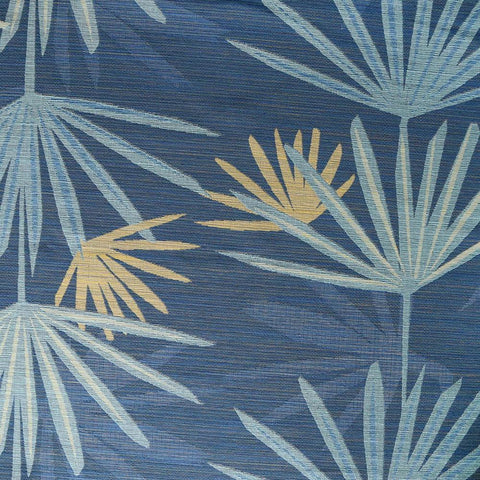 A teal blue and green palm leaf print fabric by Justina Blakeney Home.