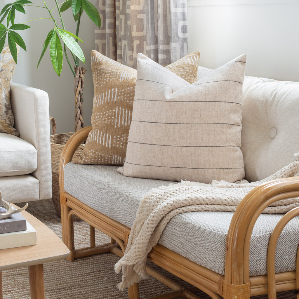 Neutral decor: Dunrobin beige and charcoal stripe pillow and Zipporah cork pillow combination