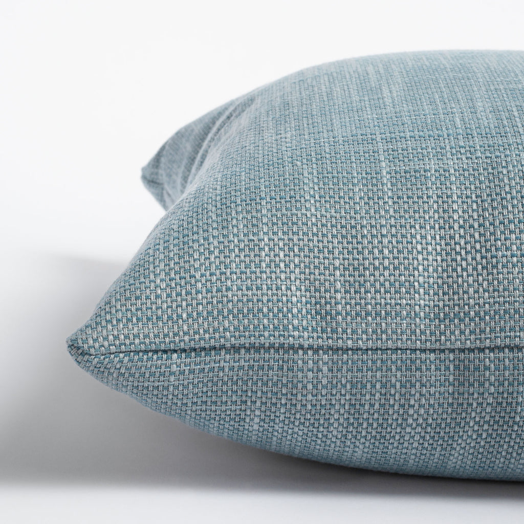 Ernesto Riviera, a textured stone blue indoor outdoor pillow : close up view