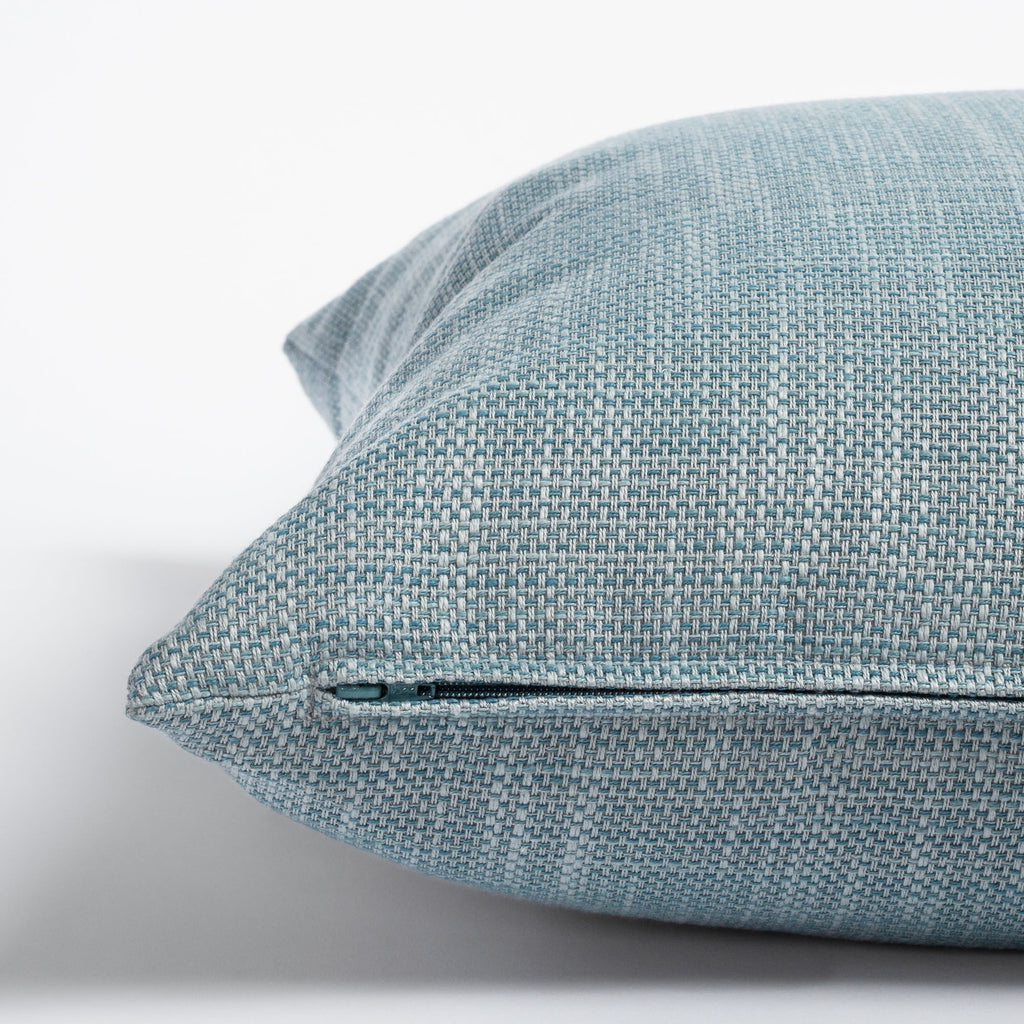 Ernesto Riviera, a textured stone blue indoor outdoor pillow : zipper detail