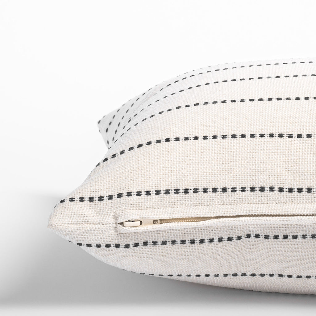 Cream and black stripe pillow: zipper detail