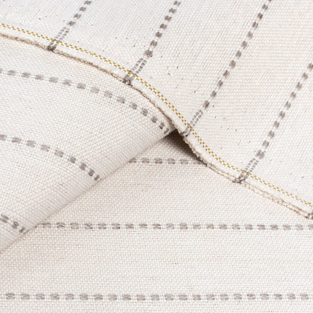 a light cream and sandy gray stripe indoor outdoor fabric :  close up view