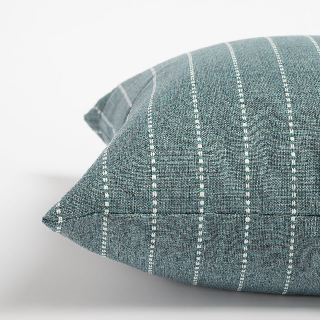 Fontana Water 20x20 pillow, a teal and white vertical stripe indoor outdoor pillow : close up side view